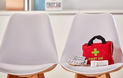First aid kit in the waiting room of a hospital Stock Photo