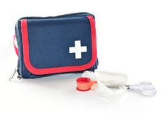 First aid kit on wite background. First aid kit with medical items: bandage, plaster and scissors,  on white background Royalty Free Stock Photography