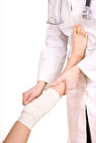 First aid at knee trauma. stock images