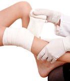 First aid at knee trauma. royalty free stock photography