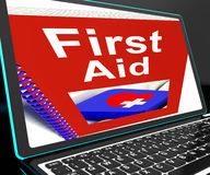 First Aid On Laptop Shows Medical Assistance. Or Emergency Treatment Royalty Free Stock Photography
