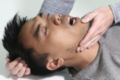First aid - man simulating a malaise Stock Photography