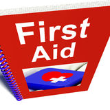 First Aid Manual Shows Emergency Medical Help Stock Images