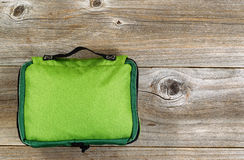 First aid medical bag on rustic wooden boards Royalty Free Stock Photography