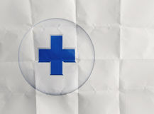 First aid medical sign on crumpled paper Stock Photo