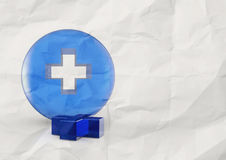 First aid medical sign on crumpled paper Royalty Free Stock Image