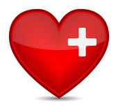 First aid medical sign on red heart shape. Royalty Free Stock Photos
