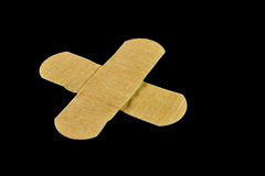 First aid. Plasters, isolated on black background Stock Images