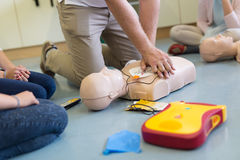 First aid resuscitation course using AED. First aid cardiopulmonary resuscitation course using automated external defibrillator device, AED Royalty Free Stock Photography