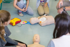 First aid resuscitation course using AED. Royalty Free Stock Photography