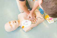 First aid resuscitation course using AED. Royalty Free Stock Photo