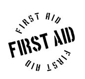 First Aid rubber stamp. Grunge design with dust scratches. Effects can be easily removed for a clean, crisp look. Color is easily changed Royalty Free Stock Photo