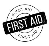 First Aid rubber stamp. Grunge design with dust scratches. Effects can be easily removed for a clean, crisp look. Color is easily changed Royalty Free Stock Images