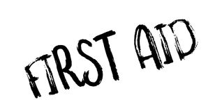 First Aid rubber stamp. Grunge design with dust scratches. Effects can be easily removed for a clean, crisp look. Color is easily changed Royalty Free Stock Image