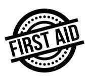 First Aid rubber stamp. Grunge design with dust scratches. Effects can be easily removed for a clean, crisp look. Color is easily changed Stock Photos