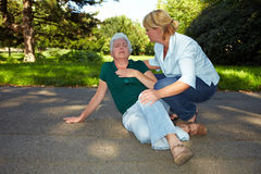 First aid for senior woman. First aid for senior women with heart attack Royalty Free Stock Photography