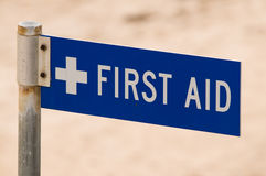 First Aid Sign. Indicating direction to seek assistance Royalty Free Stock Image