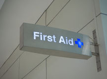 First aid sign. Electronic blue and white first aid sign (indoor Royalty Free Stock Photo