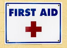 First Aid Sign on Wall Stock Photos