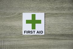 First aid sign on the wooden wall Stock Photos