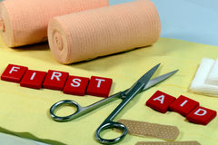 First AID. Signs and equipment for first aid kit Stock Image