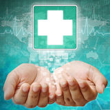 First Aid Symbol on hand Stock Photography