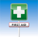 First aid traffic sign. Green First aid traffic board with text on blue sky background Stock Photography