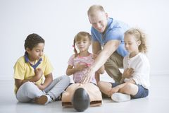 First aid trainer presenting reanimation royalty free stock image