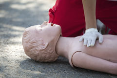 First aid training. Demonstrating CPR on a dummy Stock Image