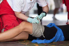 First aid training. Leg injury. Royalty Free Stock Photography