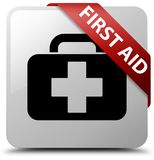 First aid white square button red ribbon in corner. First aid isolated on white square button with red ribbon in corner abstract illustration Royalty Free Stock Photos