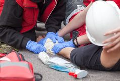 Work accident. First aid training. Arm injury. First aid after workplace accident stock photography