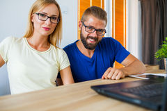 First of all: teamwork. Good day in office. Royalty Free Stock Image