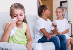 First amorousness:  girl and couple of kids apart Royalty Free Stock Photo