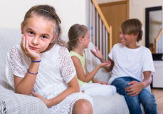 First amorousness:  girl and couple of kids apart Stock Photography
