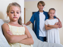 First amorousness:  girl and couple of kids apart Stock Photos