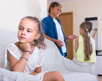 First amorousness:  girl and couple of kids apart Stock Images