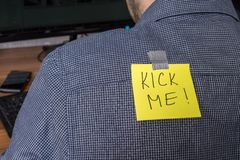First april - fools day. Note with kick me text on back Stock Photos