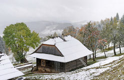 First autumn sudden snow. House in mountain Royalty Free Stock Photo