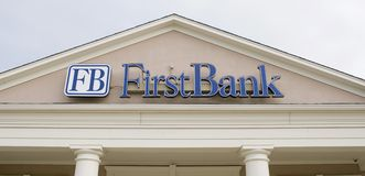 First Bank Sign. A First Bank, banking and financial center sign royalty free stock image