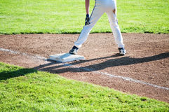 First base. A runner waits on first base for the next hit Royalty Free Stock Photo