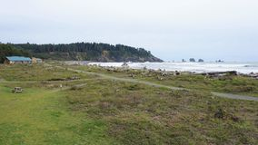 First beach coastline at La Push near Cascadia Fault. Washington state coast replete with cliffs, forests, ocean waves and banked shoreline.  Part of the Olympic Stock Photos
