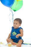 First Birthday. Adorable Little Boy with Cupcake and balloons Royalty Free Stock Image