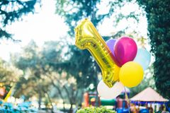 First birthday baloon. In the park royalty free stock photo