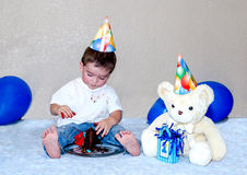 First Birthday boy with bear and cake Royalty Free Stock Photos