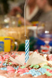 First birthday candle. Extinguished candle on the cake in honor of the first birthday Royalty Free Stock Image