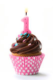 First birthday cupcake with pink candle Stock Photos
