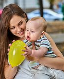 First birthday ideas. Happy mother and her baby boy outdoors. Stock Photography