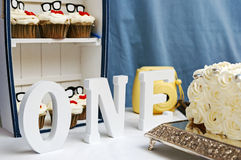 First Birthday Letters And Cupcake. One, Letters, First Birthday, Cupcakes And Cake stock photos