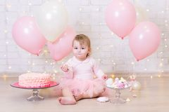 First birthday party concept - cute little girl eating cake over Stock Photo